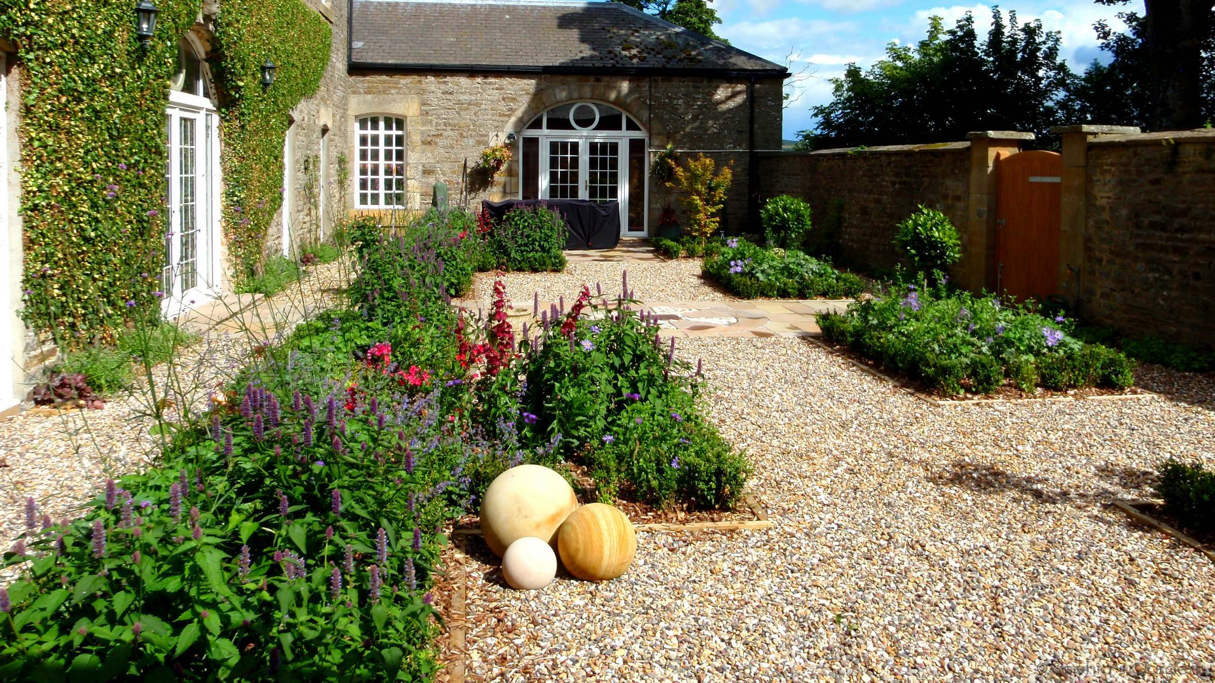 Old stone courtyard parterre garden in Weardale, by Sophia's Gardens